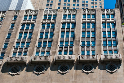 Civic Opera Building, facing the river.  Look at the original size photo to see more detail.  The building is impressive, but there's this bizarre sameness to its features on this side.  The other side is much more attractive, less industrial looking.  But -- I didn't get any photos of that.  :-)