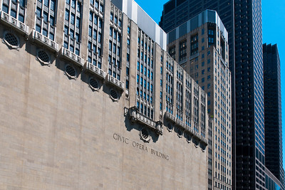 Civic Opera Building, facing the river.  Vast wall of stone, wonderful detail.  Look at the original size photo to see more detail.