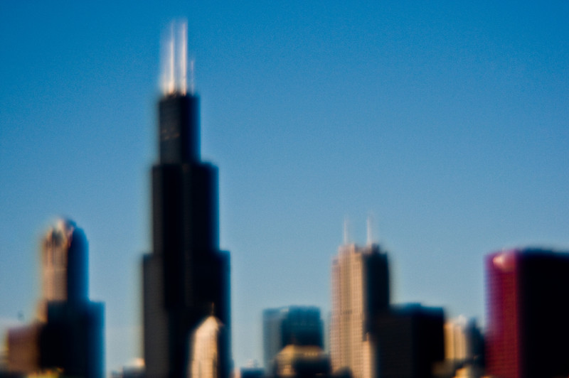 Title: Unfocused Skyline<br /> Date: November 2010<br /> The Sears Tower (Willis Tower) and neighboring buildings.  The out-of-focus look was accomplished using a plastic lens.