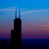 Title: Tower Against Three Colors<br /> Date: November 2010<br /> The Sears Tower (Willis Tower).  The unfocused look comes from using a plastic lens on my digital camera.