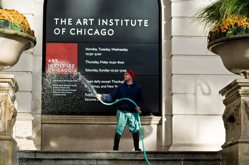 Title: Early Morning at the Art Institute<br /> Date: November 2010<br /> A groundskeeper at the Chicago Art Institute.