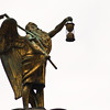 Title: Father Time<br /> Date: November 2010<br /> A small statue of Father Time on top of a clock in downtown Chicago.