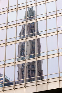 The Mather Building reflects in a neighboring skyscraper.