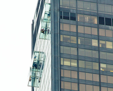 "Viewers in glass boxes 1353 feet above the street in Willis (pronounced ""Sears"")  Tower"