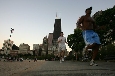 Joggers at Oak Street Beach