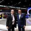 Photojournalist Ralph Hajik with Jim Rose from Channel 7 News in front of the Chevrolet Volt Exhibit, the Green Car of the year at the Chicago Auto Show on Media day.