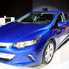 CAS59074 <br /> <br /> The Volt's new, efficient propulsion system will offer a General Motors'-estimated total driving range of more than 400 miles and with regular charging, owners are expected to travel more than 1,000 miles on average between gas fill-ups.<br /> 2016 Volt highlights:<br /> •New two-motor drive unit is up to 12 percent more efficient and 100 pounds lighter (45 kg) than the first-generation drive unit<br /> •Two-motor design enables 19 percent stronger zero-to-30 mph acceleration <br /> •Battery capacity has increased to 18.4 kWh using 192 cells (96 fewer than current generation) with weight reduced by more than 20 pounds<br /> •Regen on Demand™ feature enables driver control of energy regeneration via a convenient paddle on the back of the steering wheel  <br /> •New 1.5L range extender, designed to use regular unleaded fuel, offers a combined GM-estimated fuel efficiency of 41 mpg (EPA estimate pending)<br /> •Stronger body structure and quieter ride<br /> •New braking system with improved capability and blended Regen feel<br /> •New, five-passenger seating with available rear heated seats <br /> •Location-based charging capability <br /> •120V portable cord set has a simpler, compact design with more convenient storage location <br /> •Available illuminated charge port<br /> <br /> The 2016 Volt goes on sale in the second half of 2015.