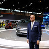 Photojournalist Ralph Hajik taking a picture of Jim Rose from Channel 7 News in front of the Chevrolet Volt Exhibit at the Chicago Auto Show on Media day.