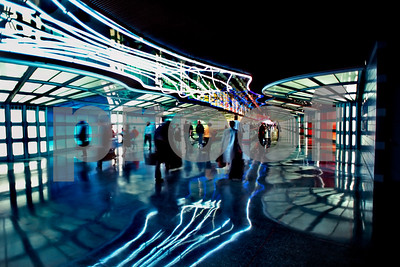 Chicago, IL, USA - Interior Hallway in Logan International Airport, Lit up with Neon Lighting.