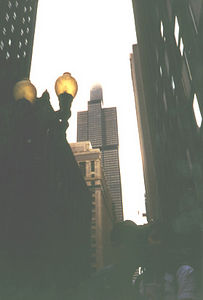 "<div CLASS=""Caption"">     Sears Tower 			<div class=""Location""> 	    Downtown, <a href=""http://www.yahoo.com/Regional/U_S__States/Illinois/Cities/Chicago/"" target=""_Ricky"">Chicago</a>, <a href=""http://www.yahoo.com/Regional/U_S__States/Illinois/"" target=""_Ricky"">IL</a></div></div>     <div CLASS=""Detail"">     Here is a picture I took of the Sears Tower stretching into the clouds. Kit and Chelle     are at the bottom right of the picture giving each other a smooch but it didn't come out     so well. I really wanted to go to the observation deck and look over Chicago (the     tower is 110 stories tall,) but the line was as long as the building is high. Only     one of the two things I wanted to see but didn't on the trip.</div>"