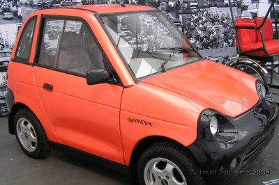 "This little car is called a Reva and runs on batteries, fits four people, charges in three to six hours, range of 90kms miles, and top speed 70kph. They are mainly in India, but there are a few in Switzerland and China. I want one.  This was an exibit at the ""Massive Change: The Future of Global Design"" held at the Museum of Contemparary Art. ""Canadian designer Bruce Mau and the Institute without Boundaries' show is not about the world of design; it's about the design of the world"""