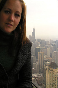 Natarsha in the John Hancock Centre, with the Sears Tower in the back ground.