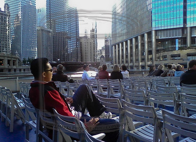 Our principal, sitting on the deck of a Wendella boat, about to leave on the Chicago River architecture tour, 20Oct10