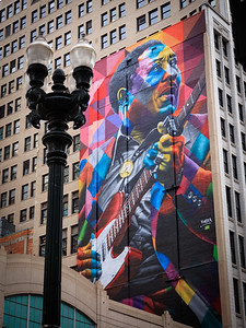 Cool mural of Chicago blues man Muddy Waters, seen from State Street.