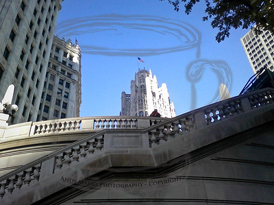 The Wrigley building and the stairs down to the Wendella tour dock. The Tribune Tower's winning design and flag are in the back center of the frame. 20Oct10