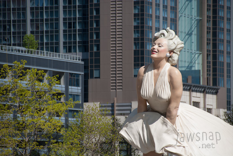 "<span id=""title"">Marilyn</span> I had heard about this Marilyn Monroe statue a few months ago, but I didn't really appreciate how giant it is (not that this photo helps with that...). Every time we walked or rode by it, someone would walk underneath, look up her skirt, and then smile to have their photo taken. Men, women, kids... it was a spectacle."