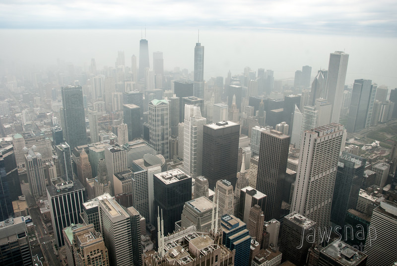 """<span id=""""title"""">City View</span> This is the view looking northeast from Willis (Sears) tower. The three tallest buildings from left to right are the John Hancock Center, Trump International Hotel and Tower, and the Aon Center.  It was a terrible day for visibility, but it was still quite fun to see the view from the 103rd floor."""
