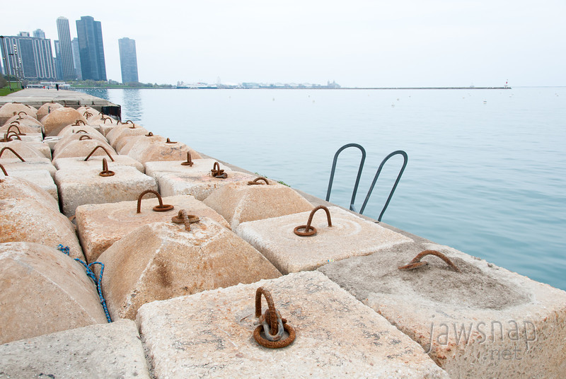 "<span id=""title"">Weights</span> These appear to be weights for the buoys where folks park their boats in the harbor. You can see some buoys out in the water, but no boats - I guess it's still too cold."
