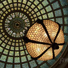 "<span id=""title"">Tiffany Dome</span> Apparently this is the largest Tiffany art glass dome in the world. I don't know if there are larger non-Tiffany domes or something, but that's what the sign says. It's pretty impressive, and the entire room is gorgeous, although badly lit. In case you can't tell, this chandelier hangs down from the center of the dome.  The inscription around the bottom of the dome says: ""Books are the legacies that a great genius leaves to mankind which are delivered down from generation to generation as presents to the posterity of those who are yet unborn."""