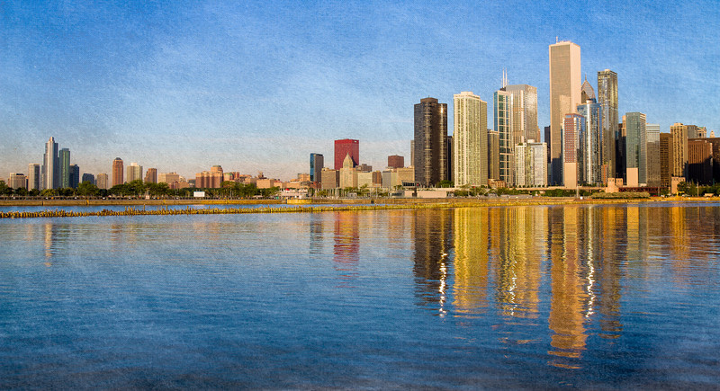 Arrived at Navy Pier at 6 AM...no clouds but great reflections. To add some interest I textured the photo then painted back in the original city.