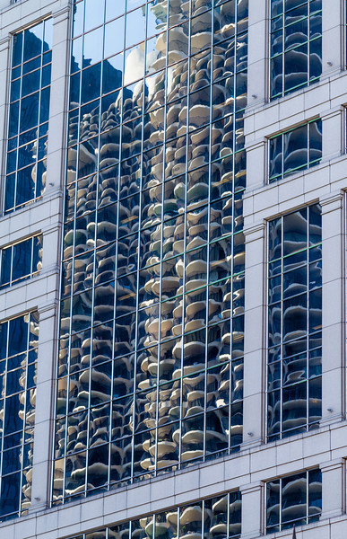 Looks like mushrooms in this building.  Took the architectural boat tour through the city. Learned that many of the buildings were designed for one specific location for one reason or another. This one was placed to reflect Marina City across the river.