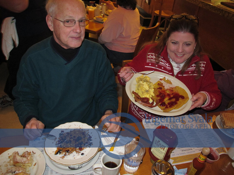 Lisa...with SWEDISH PANCAKES and lingonberries and Roger porridge and oatmeal combination..Both plates empty soon.