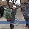 I saw this couple walking toward us with the live Christmas tree...After they passed us, I walked back to ask them, can I take a classic Kodak Christmas Photo ?  She is from Columbus, he from Dayton. This was taken when we were walking from the Condo to Roger and Lisa's Sunday morning restaurant.
