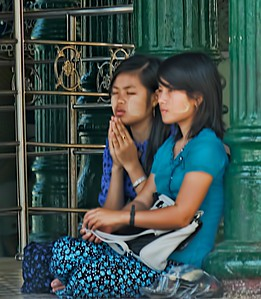 Two young girls praying.