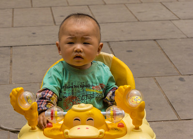 One of many children in the market in Weishan village