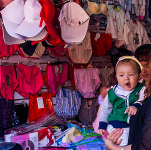 Tired baby in Lijiang market