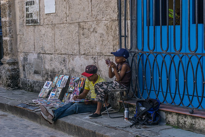 Street artist and his child in Old Havana