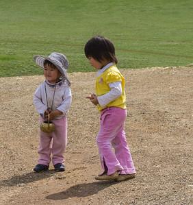 Children outside a roadside stupa.
