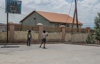 Children playing just outside the factory.