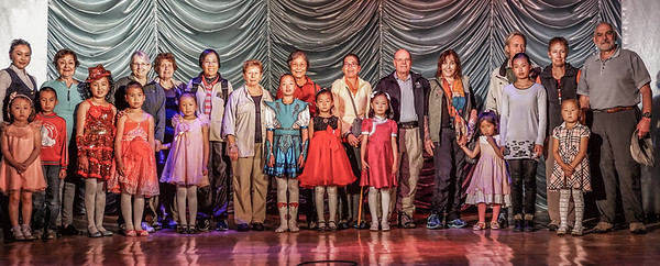 The travelers and the children all on stage.