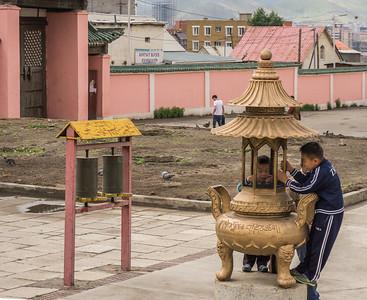 Children having fun in front of the Gandan Monastery