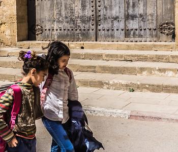 School children in deep conversation on the way home from school