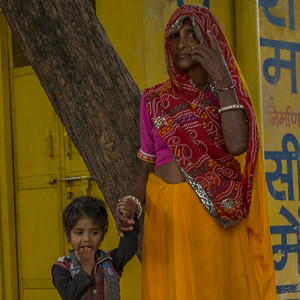 A grandmother and child in the village