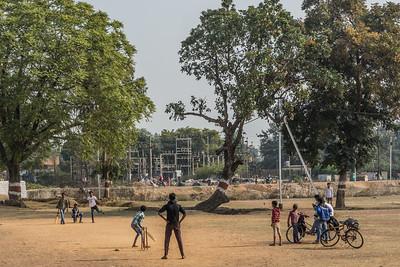 A cricket match adjacent to the beautiful temples at Khajurahu.