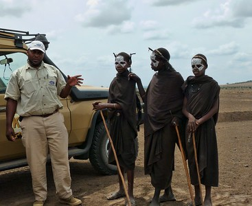 Young Masai who coming of age dress like this and wear the face paint as part of the initiation process.