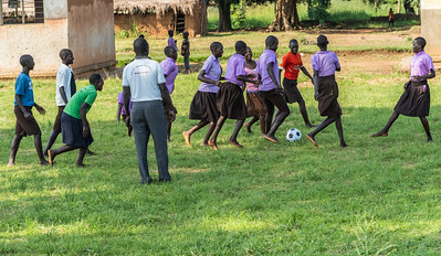 Another photo of children playing soccer, this time an all female team.