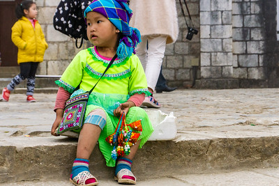 H'mong on her own with small trinkets for sale