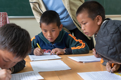 We visited a school in Sin Chai village.  The boys are practicing calligraphy,