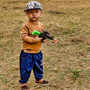 A little boy at a fair celebrating Tet in the mai Chau Valley