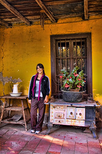 My Goddaughter, Raquelita Jimenez Celsi taken on the back porch at the house of friends in Isla de Maipo. The house was build by the great grandfather of the current owner and is one of the oldest homes in the town. Walls are made of adobe.