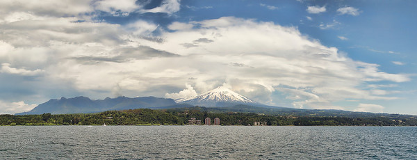 Panorama of Pucón, Chile taken from the middle of the lake. Volcano Villa Rica is the peak in the middle. This was taken in January (one month into summer in Chile) - note the snow on the mountain in spite of the warm weather.