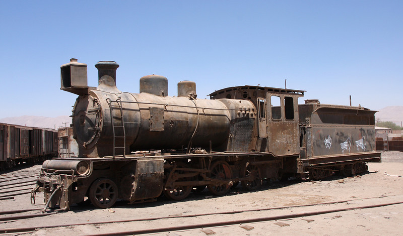 Old steam-train at Baquedano. The town used to be an important cross-road for trains but with the end of the saltpeter mining in the region, the trains were unemployed and left to gather dust a the old station