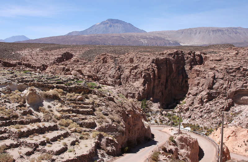 """Descend towards Toconce - once a prosperous town with a lot of agricultural activity - the many terraces still testify to this past. The continuous growth of the huge copper mine at Chuquicamata however has """"sucked-up"""" most of the available water leading to a near collapse of the town of Toconce..."""