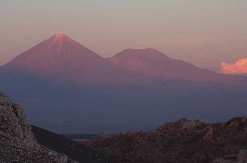 Last light on Licancabur volcano seen from Valle de la Luna. The Licancabur is 5916 meters high and was a place of worship for the Inca. Not hard to understand why given its shape and imposing presence in the valley.