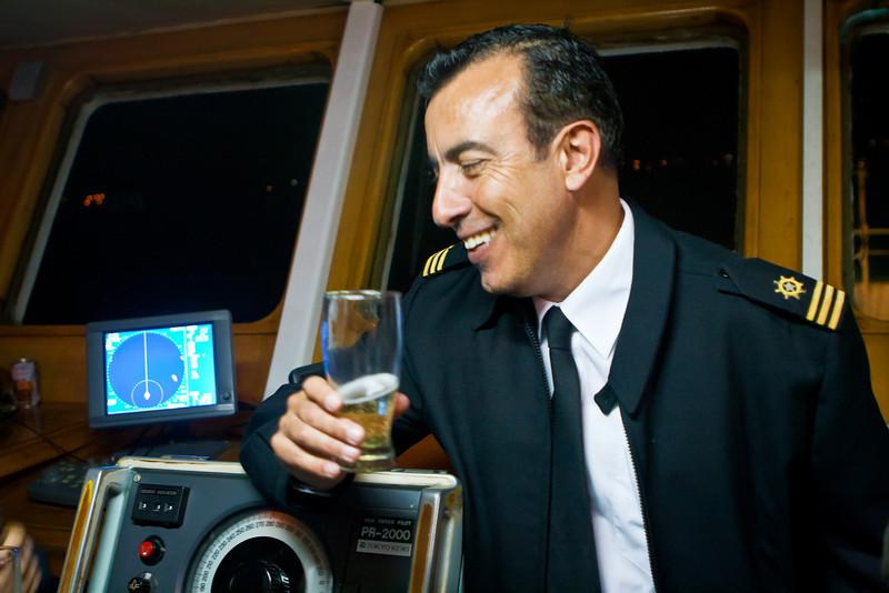 The captain of the <em>Don Baldo</em>. Celebrating New Year's Eve on the bridge.