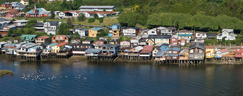<em>Palafitos</em>. In Chiloé, when they build houses over the water, on stilts, they are called <em>palafitos</em>.